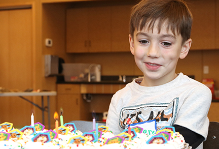 Boy smiling at his birthday Party