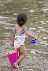Girl paying at Lake Byllesby Beach.