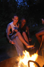 Teens making s'mores.